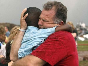 A teacher hugs a child at Briarwood Elementary school after a tornado destroyed the school in south Oklahoma City, Monday, May 20, 2013.
